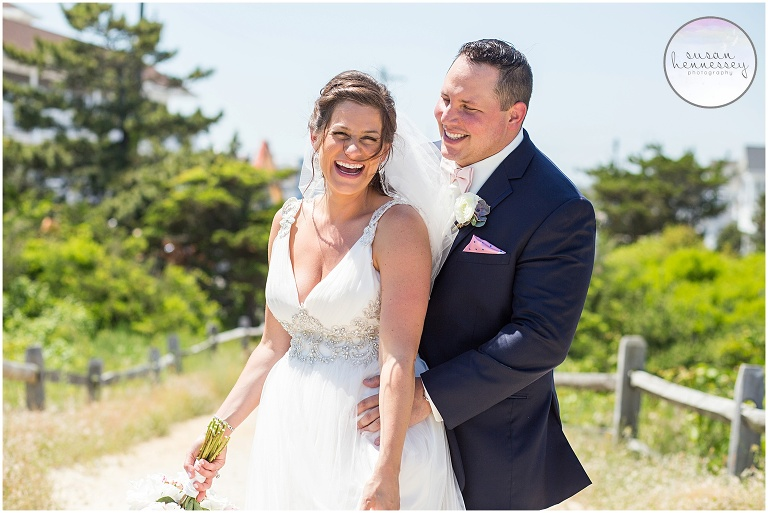Couple laugh on the beach at their Icona Golden Inn Wedding - Photography by Susan Hennessey Photography