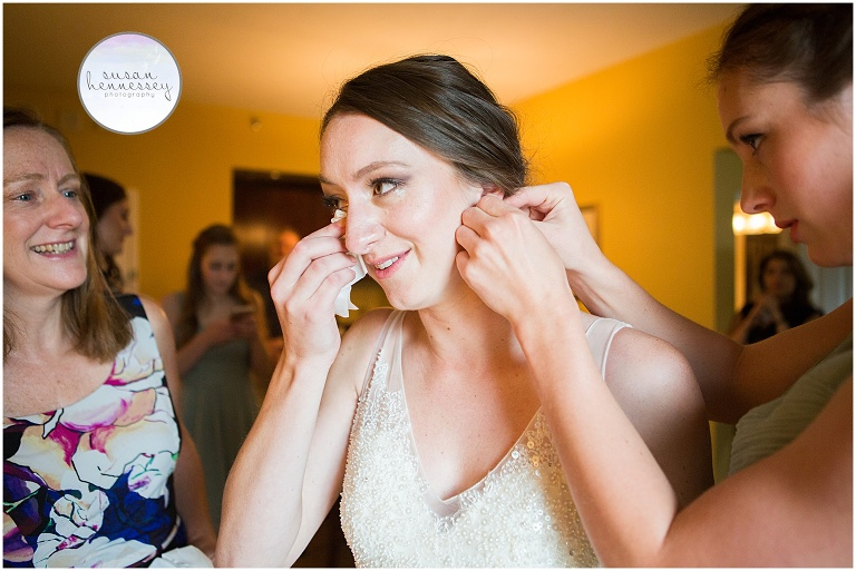 Emotional moment for bride on her wedding day while getting ready at Nassau Inn in Princeton