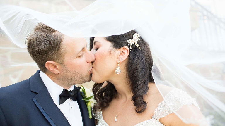 Couple kissing at Park Savoy Wedding - Photography by Susan Hennessey Photography, a South Jersey wedding photographer