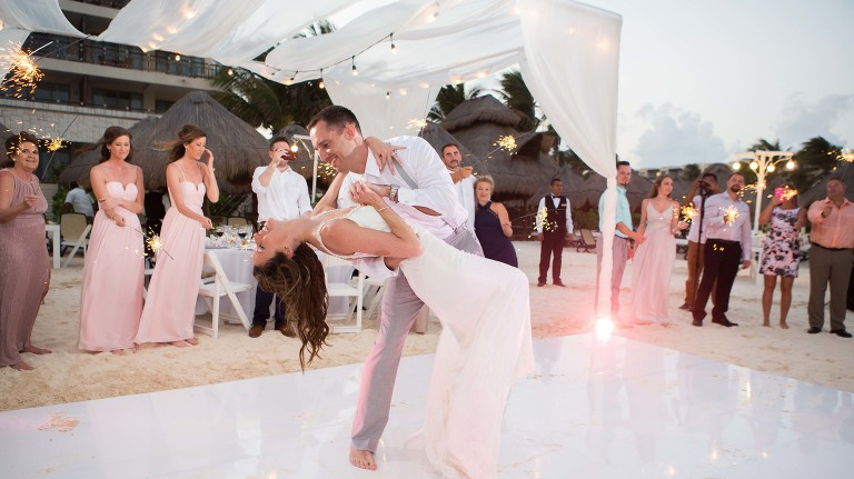 Bride and Groom enjoy their first dance at their destination wedding in Mexico - Photography by Susan Hennessey Photography, a South Jersey wedding photographer
