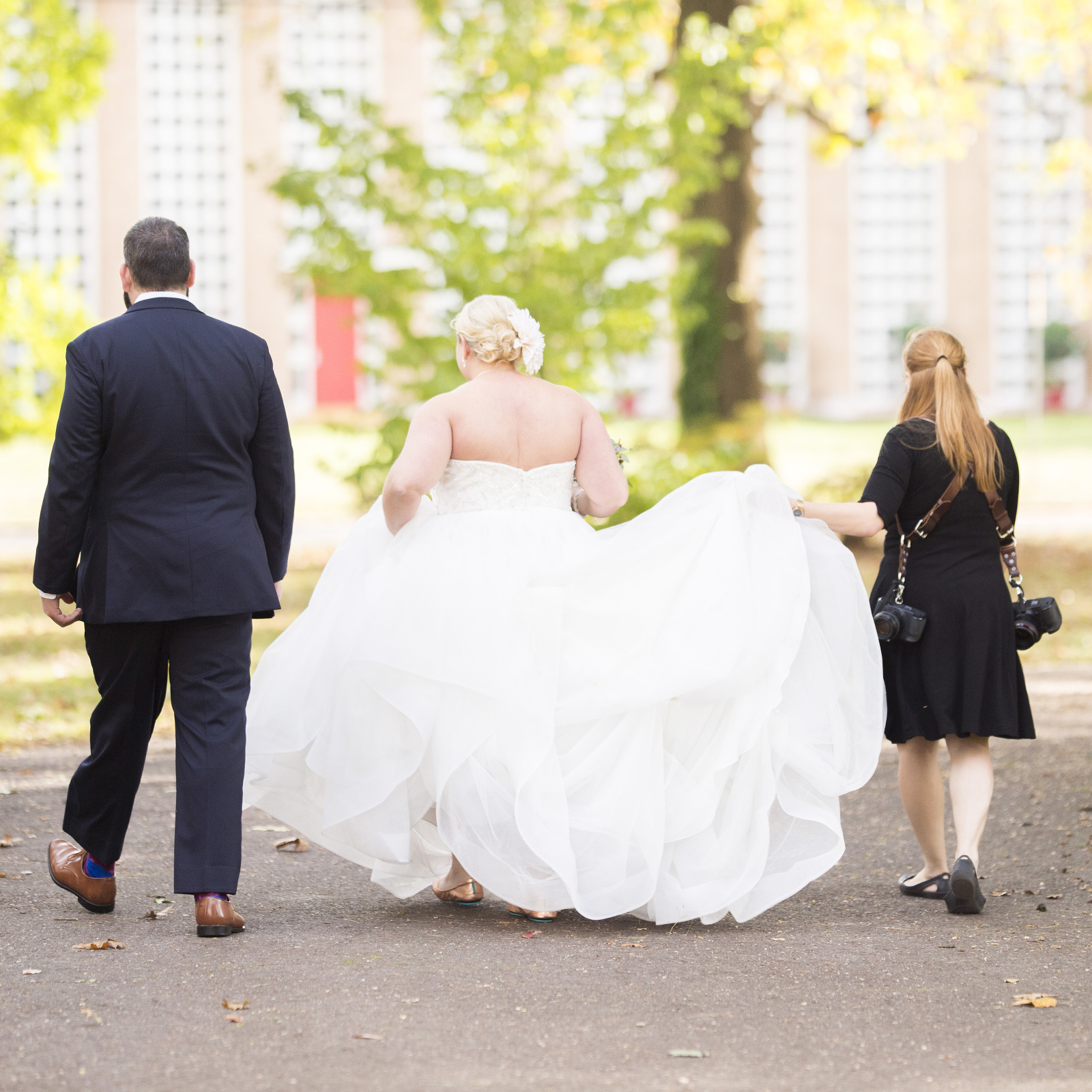 South Jersey Wedding Photographer - helping bride with her dress