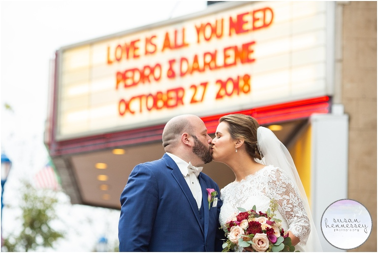 Bride and Groom pose in front of the Colonial Theatre marquee during their Phoenixville Foundry Wedding