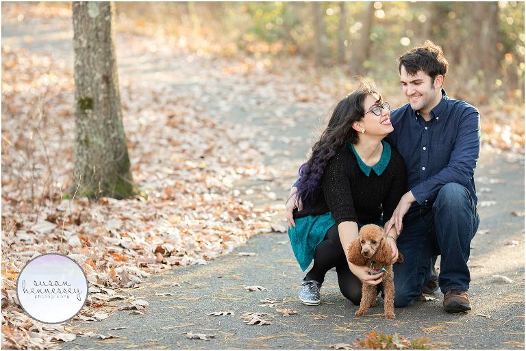 Couple pose with their dog at their Blueberry Hill Engagement Session