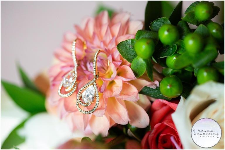 Bride's earrings on bridal bouquet.
