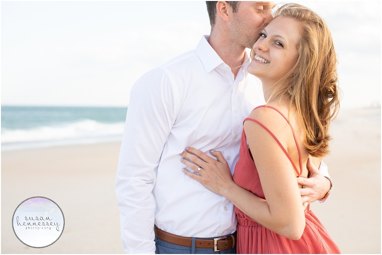 A happily engaged couple at the shore.
