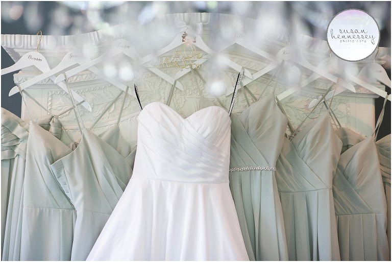 Bridal gown and bridesmaid dresses hanging