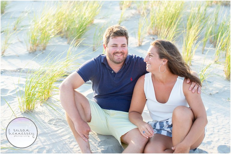 A couple sites on the beach at their Wildwood Crest engagement session