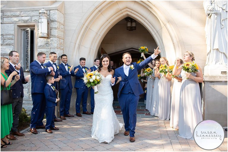 Bride and groom exit church with bubbles.
