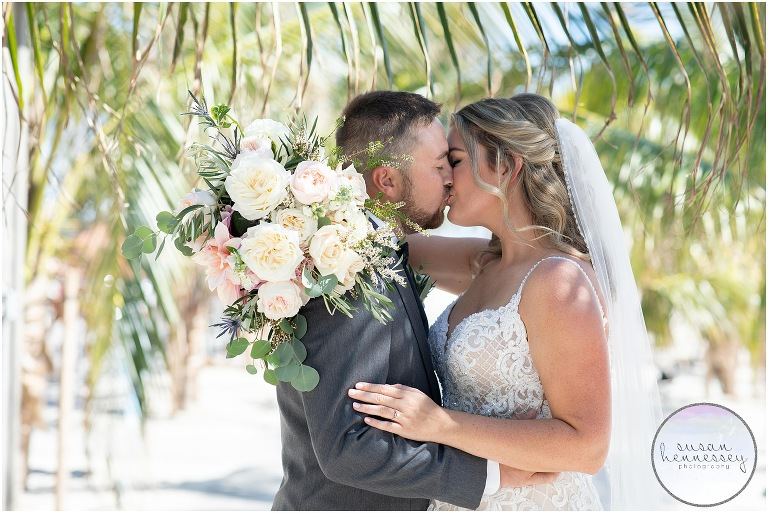 A bride and groom are married at ICONA Diamond Beach Wedding after postponing wedding three times.
