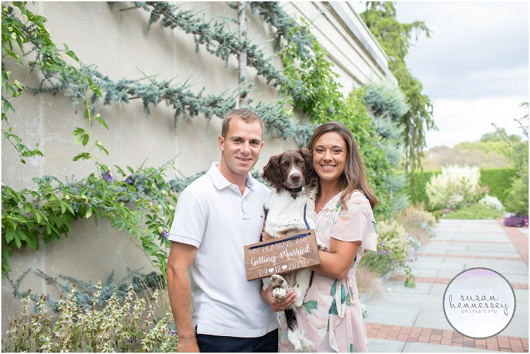 An engaged couple pose with their dog at their Philadelphia engagement session.