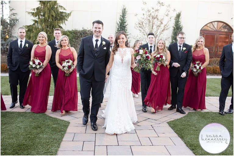 Bridal Party walking at outdoor winter wedding
