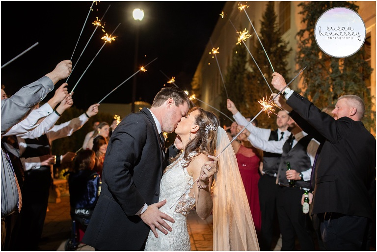 A bride and groom with sparklers during their The Merion wedding