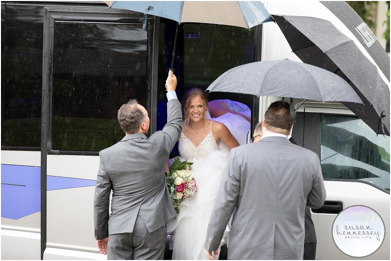 Bride arrives for her microwedding ceremony in the rain