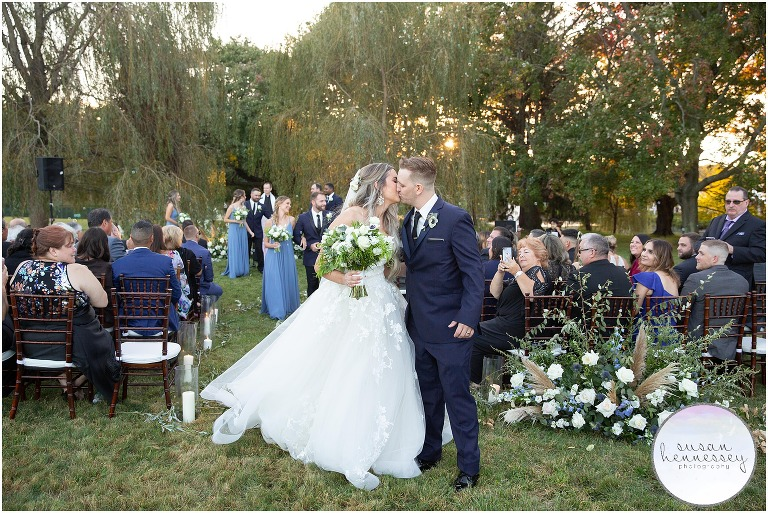 Ceremony in the willow trees at Windows on the Water at Frogbridge Wedding