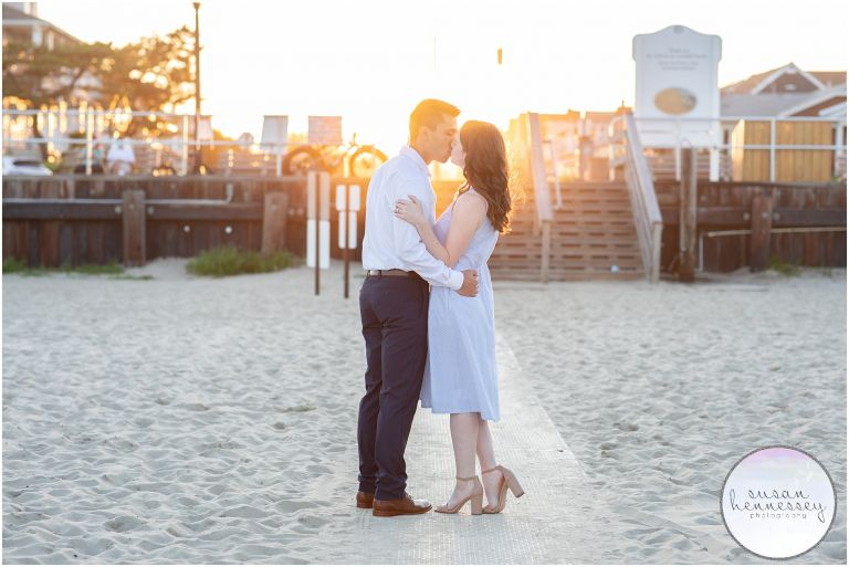 An engaged couple kiss during sunset at their Bradley Beach Engagement Session