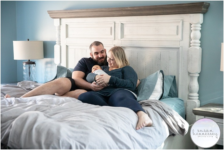 Family photos taken in master bedroom at in home newborn session